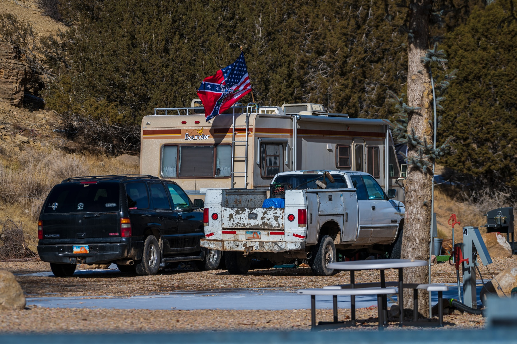 Mt Carmel, Utah, United States- 01312021: an RVer put a blended Gadsden USA Confederate Flag, Triple Threat Flag on his RV near Zion National Park.